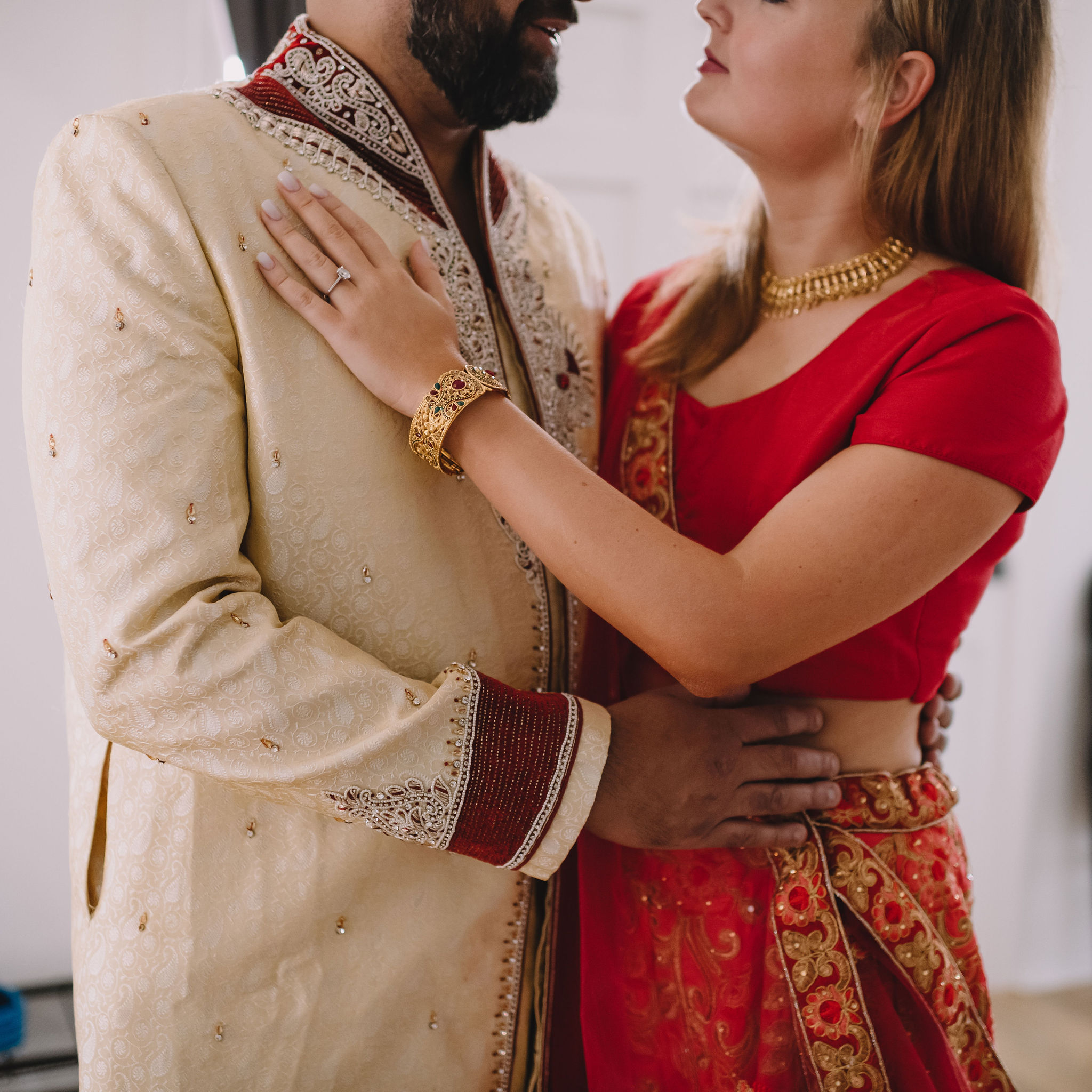 Rachel and Jimmy's wedding weekend included a Mehndi Party. For this event, Rachel wore a traditional Lehenga in red and gold and Jimmy wore a Sherwani with red embroidered detail.