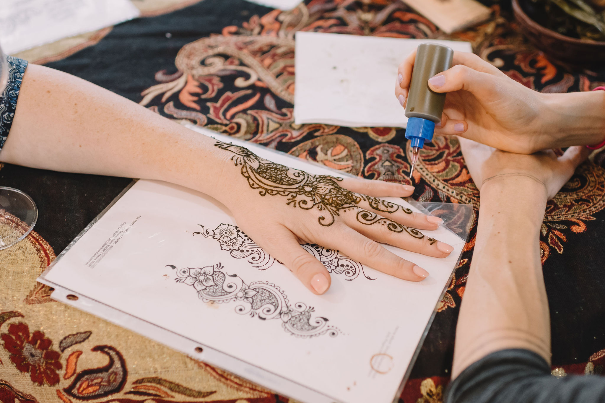 Laura Sheffield of New Orleans Henna created beautiful Henna art on wedding guests' hands.