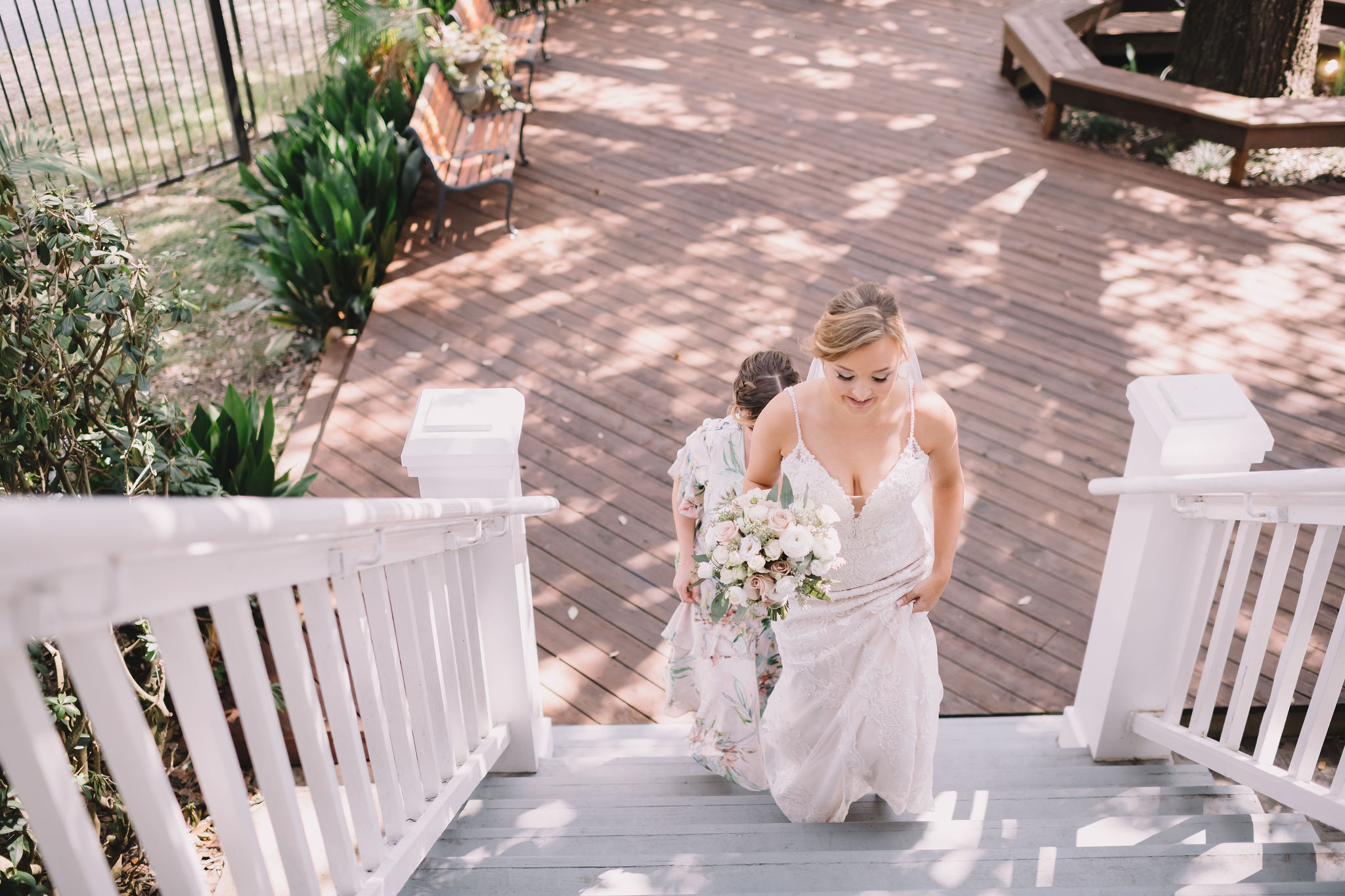 Rachel walks up the steps at Compass Point for the first look on the wedding day.