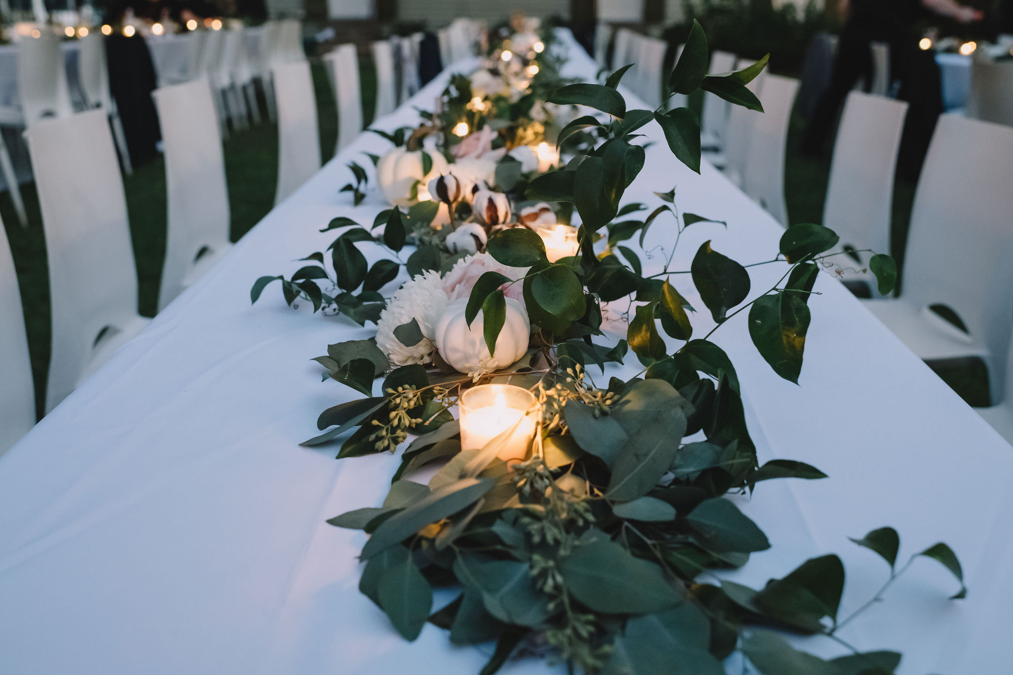 Greenery and candles decorated the reception tables.