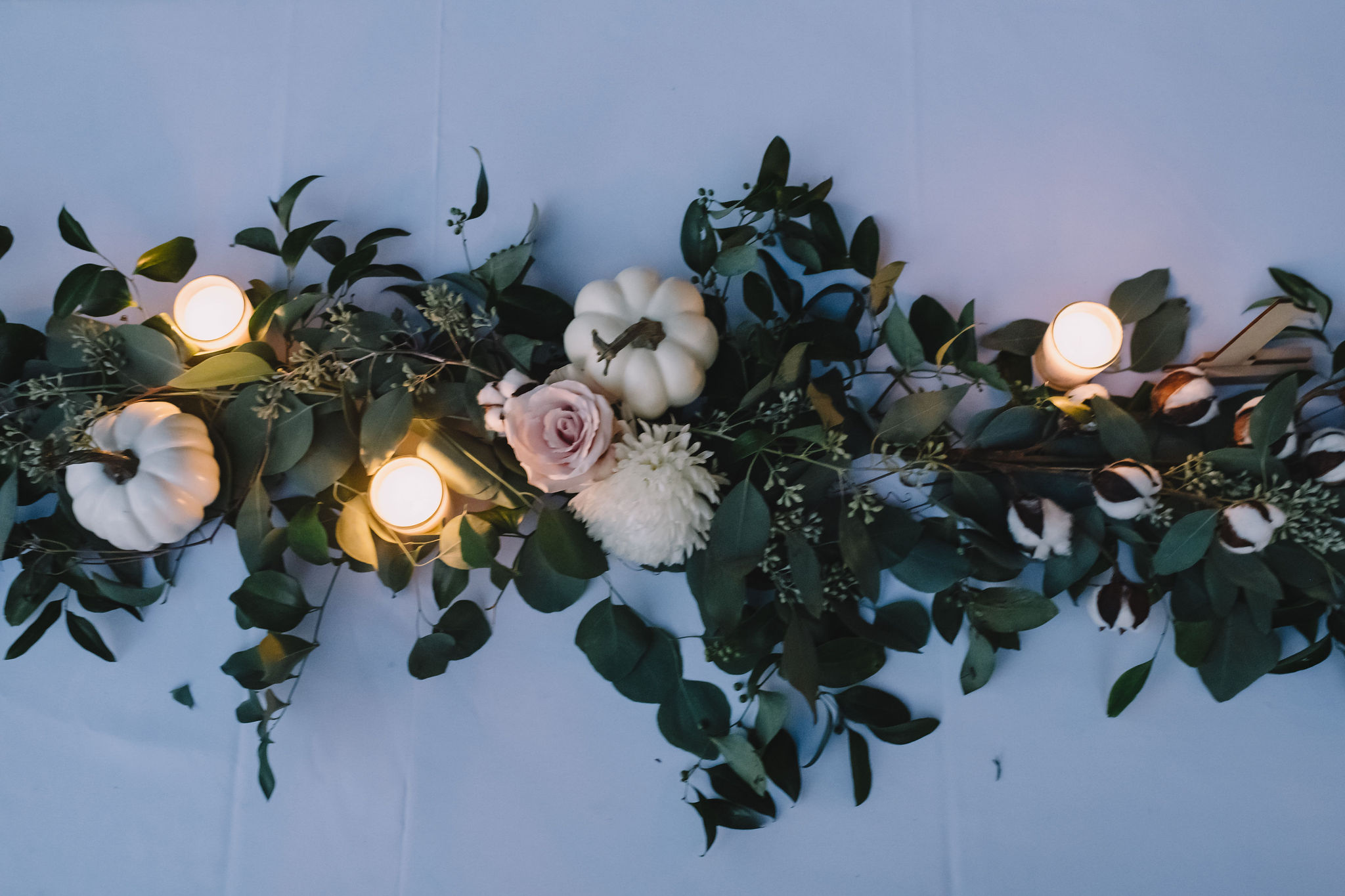 Greenery and candles decorated the reception tables. Photo by Rare Sighting Photography