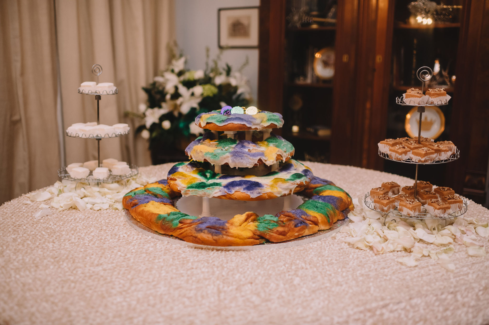 Instead of a traditional wedding cake, Rachel and Jimmy treated their guests to a four tier king cake and petit fours from Haydel's Bakery.