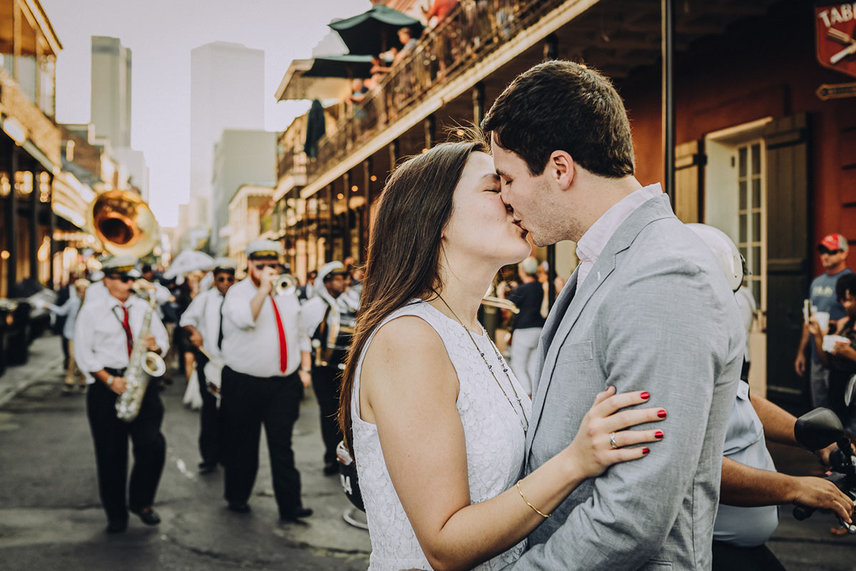A bride and groom kiss during their Second Line on Bourbon Street. Photo: Capture Studio Photography