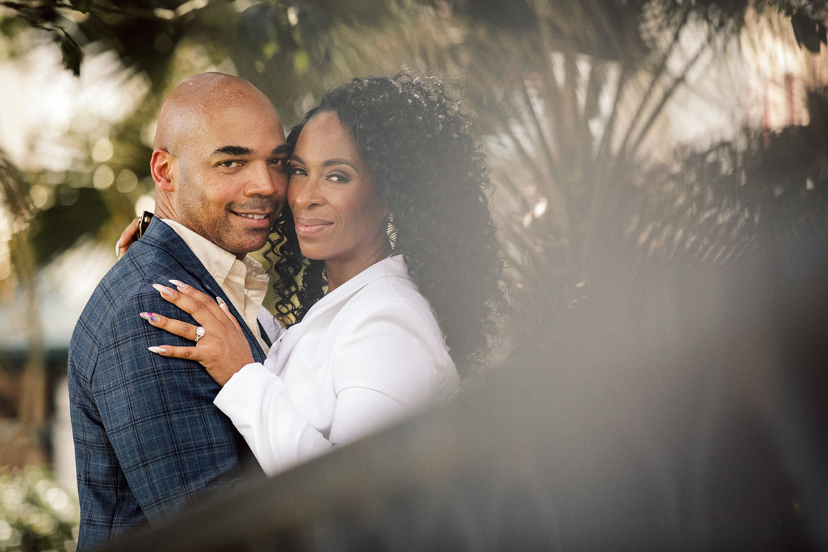 An engaged couple pose for engagement photos. Photo: Capture Studio Photography
