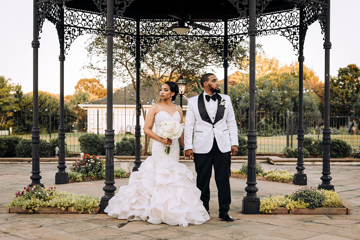 A bride and groom pose for wedding portraits at Chateau Country Club. Photo: Capture Studio Photography