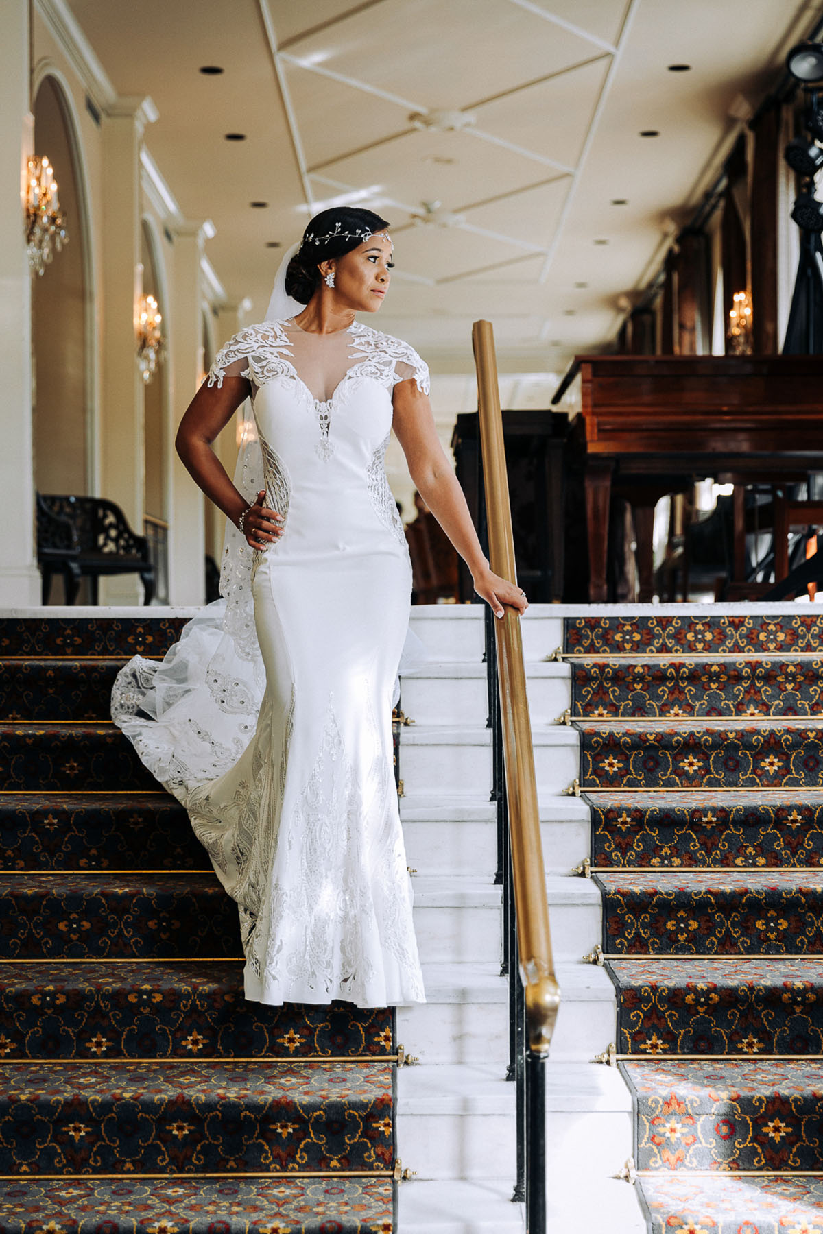 A bride poses for a photo in the lobby of the Omni Royal Orleans Hotel. Photo: Capture Studio Photography