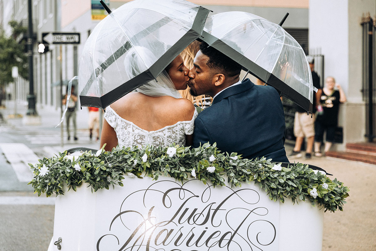 Newlyweds kiss as they leave their wedding in a pedicab in the French Quarter. Photo: Capture Studio Photography