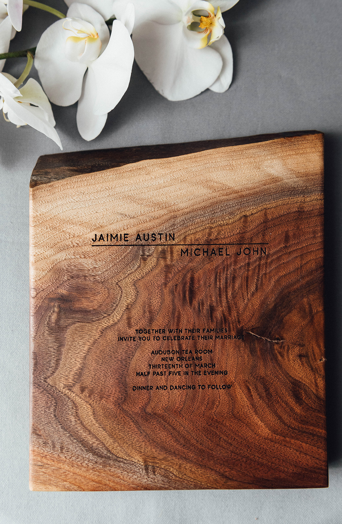 wedding invitation etched into wood