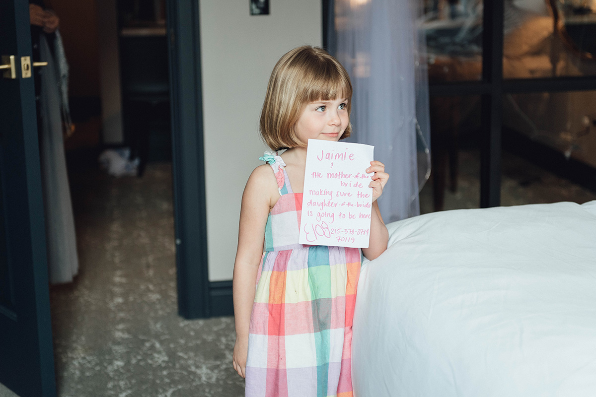 little girl holding note for bride