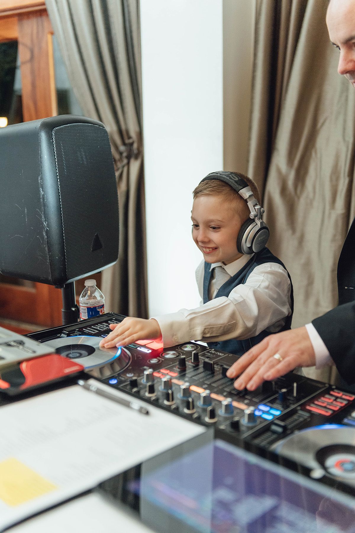 boy helping wedding dj