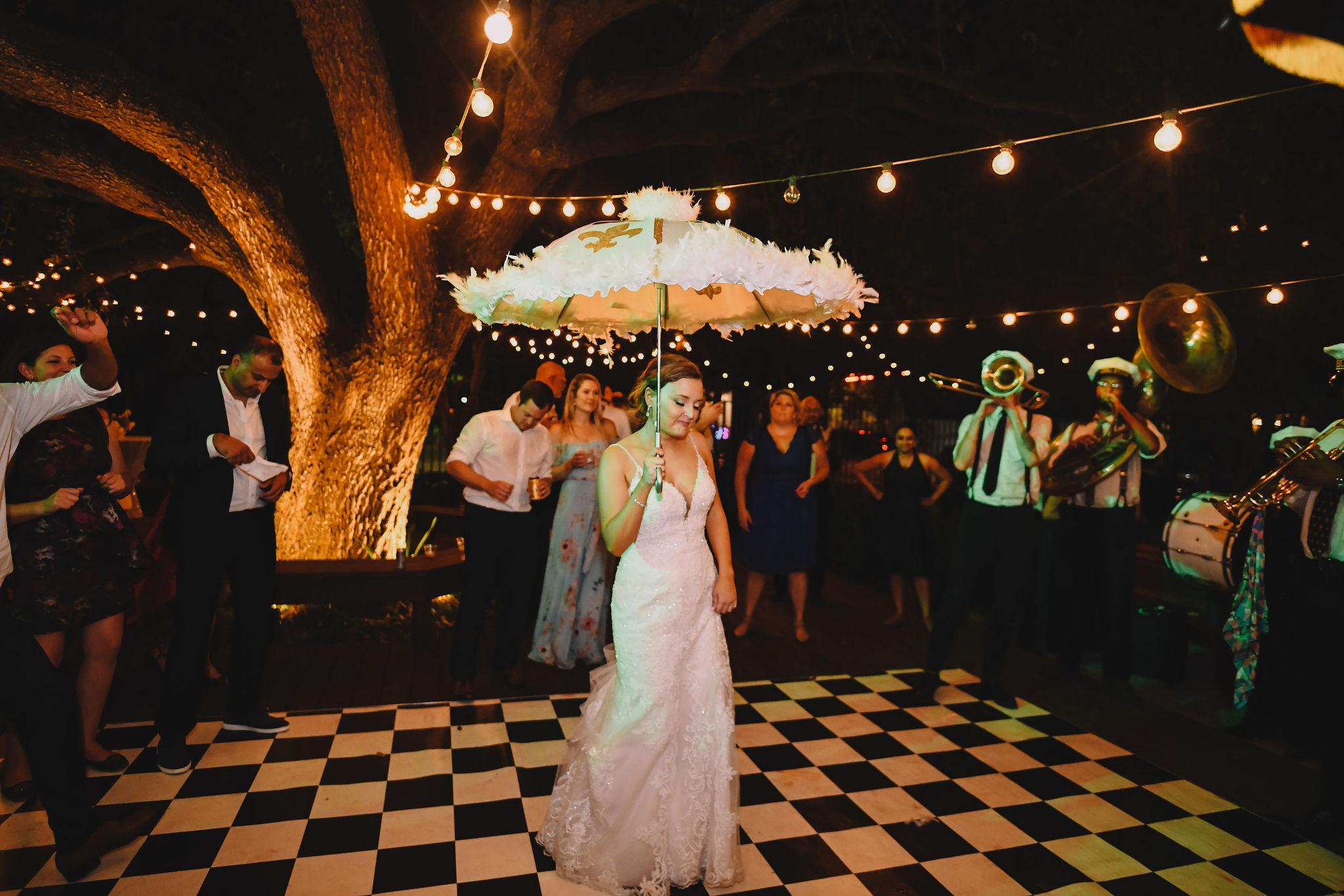 Rachel dances with her second line umbrella.