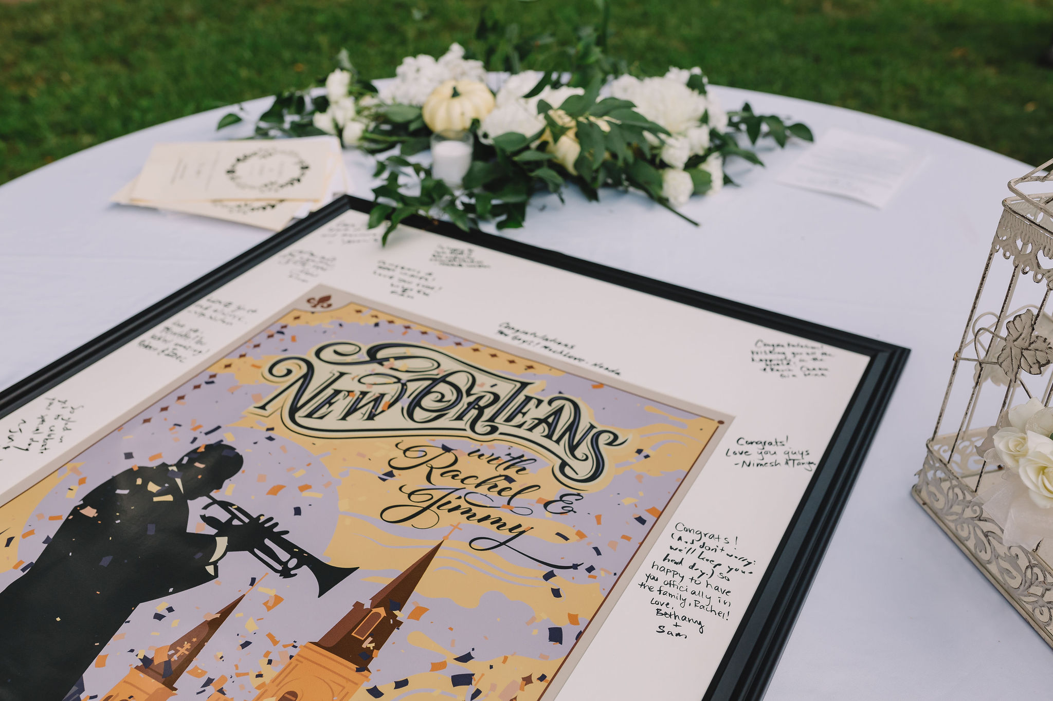 The couple opted for a non-traditional guest book for their wedding. The best man designed the image on the framed print that was also used for the Save the Dates!