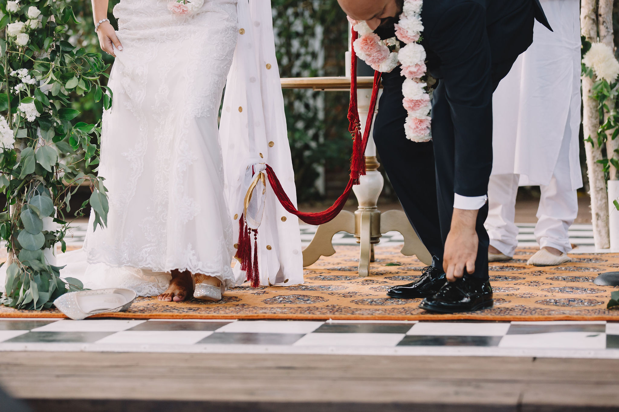 Jimmy removes his shoes for the wedding ceremony.