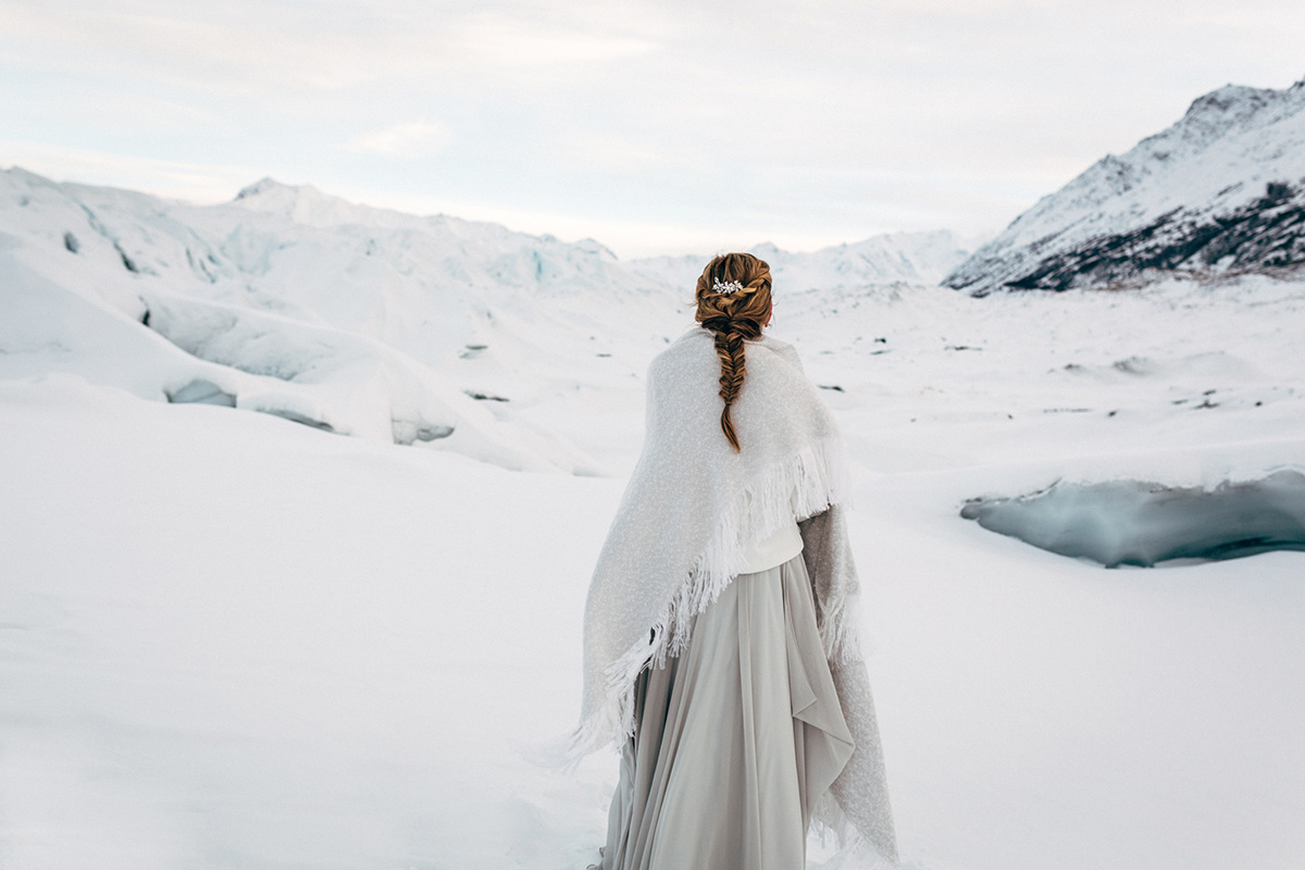 Glacier styled shoot bride walking away from the camera. Photo: Anne Marie Moran