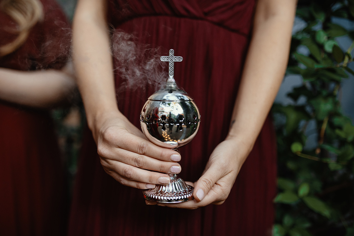 A bridesmaid holds a silver incense burner. Photo: Dark Roux