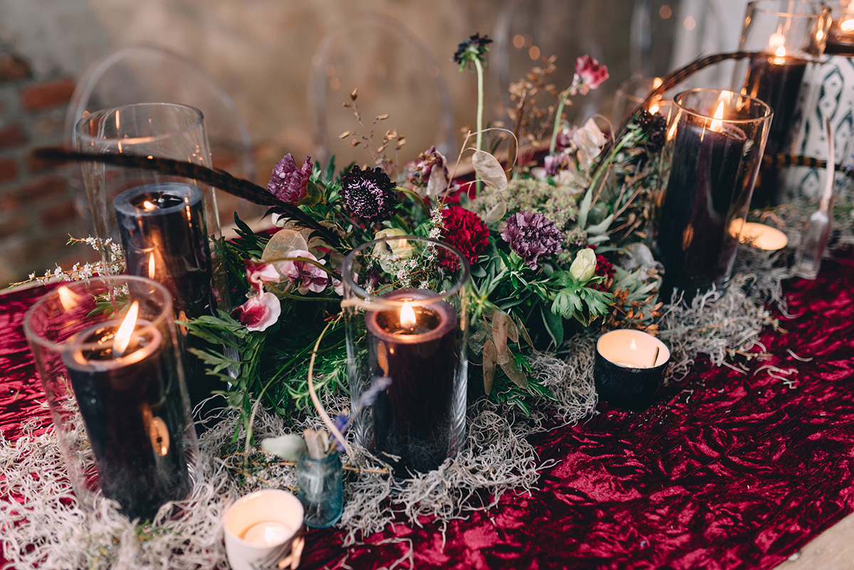 Wedding reception table florals and candles. Photo: Dark Roux