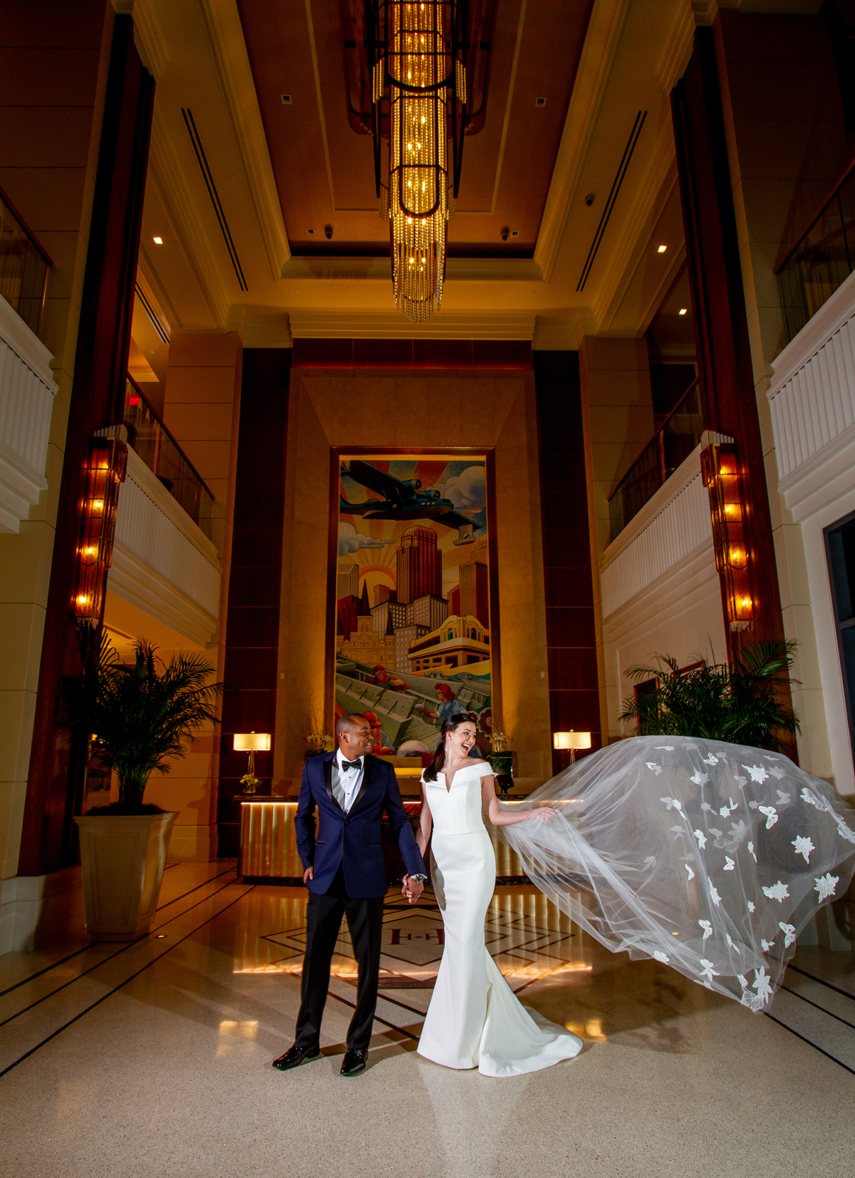 A bride and groom in the lobby of the Higgins Hotel (from the cover of New Orleans Weddings Magazine Spring 2020 Issue). Photo: Jessica The Photographer