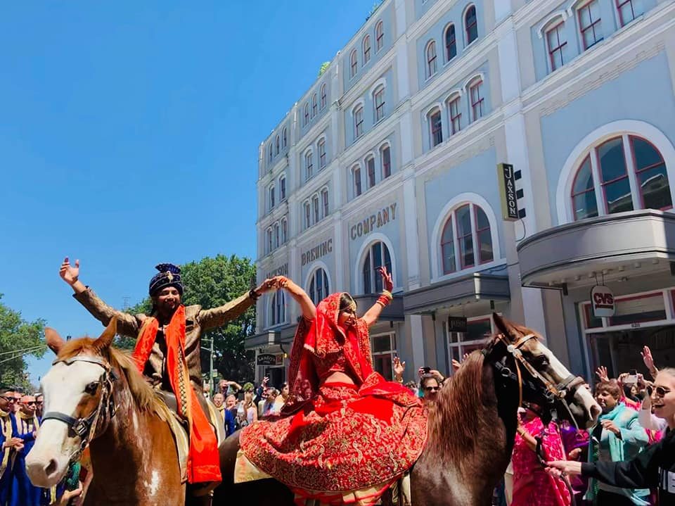 A double baraat on Decatur Street in New Orleans. Photo: Jessica The Photographer