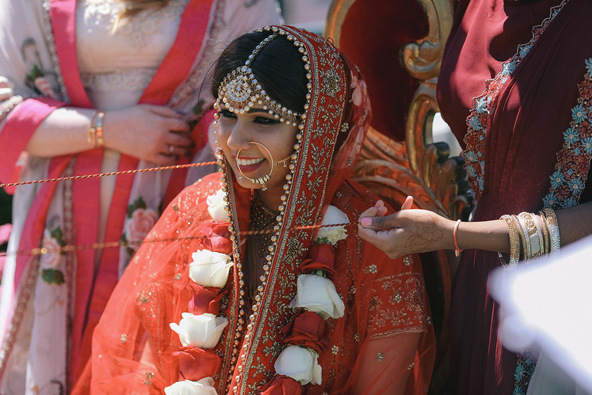 An Indian wedding ceremony on the terrace of the Riverview Room in New Orleans. Photo: Mary M Cinema