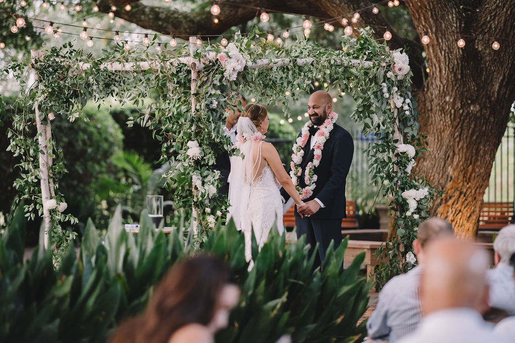 A wedding ceremony under the oaks at Compass Point Events. Photo: Rare Sighting Photography