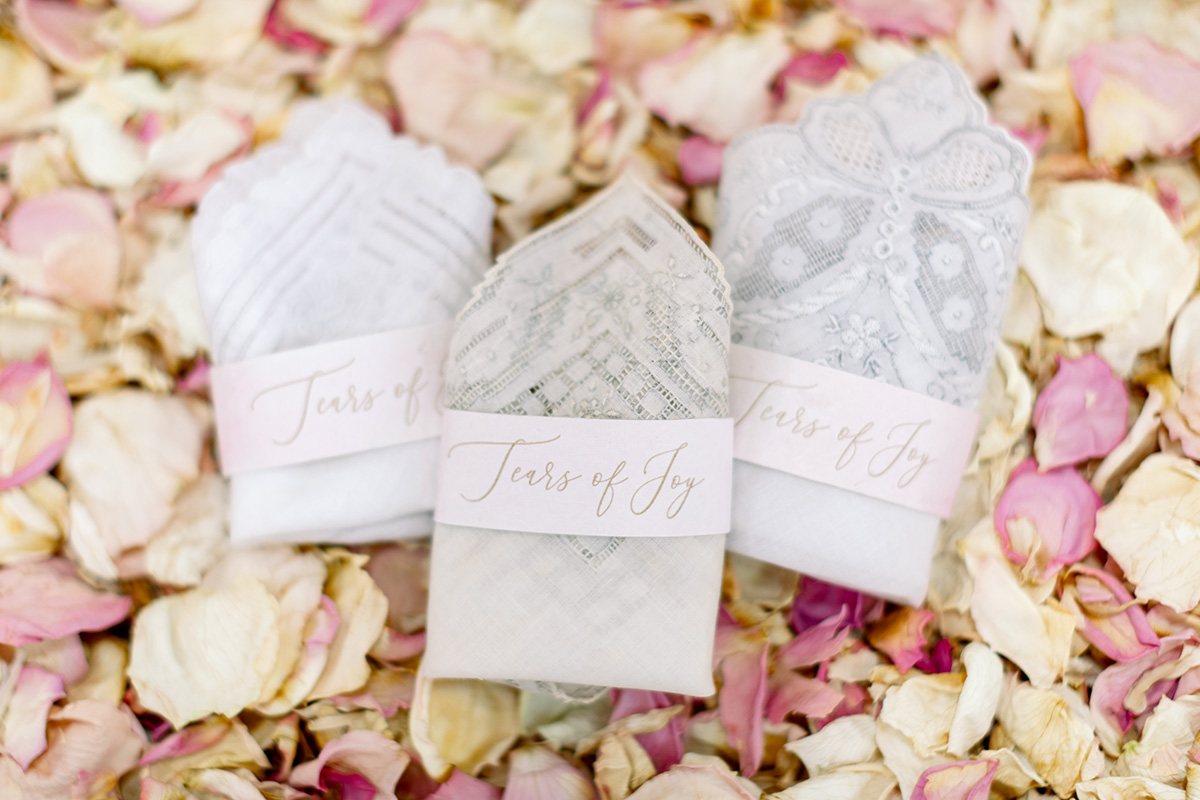 Eco-friendly vintage handkerchief display for wedding guests. Photo: Sarah Alleman Photography