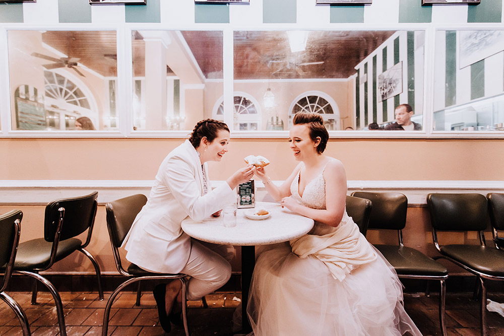 Brides At Cafe Du Monde Toasting Beignets