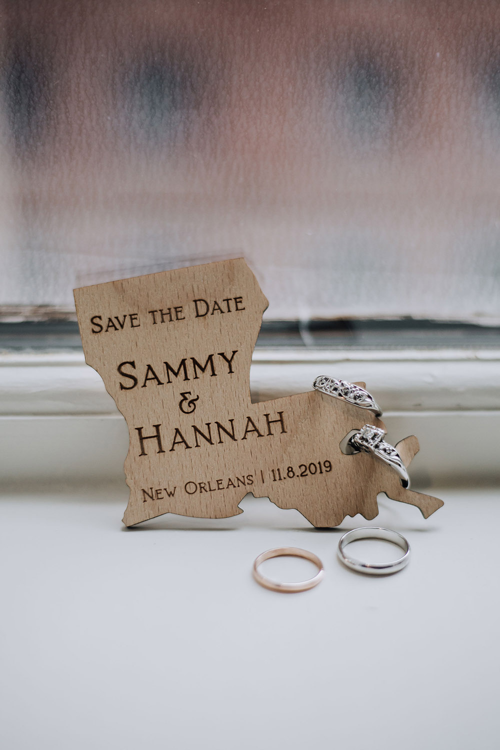 wooden louisiana shape save the date with couple's names engraved