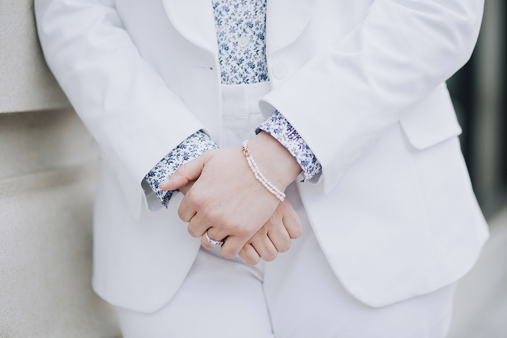 close up of bride's hands and jewelry