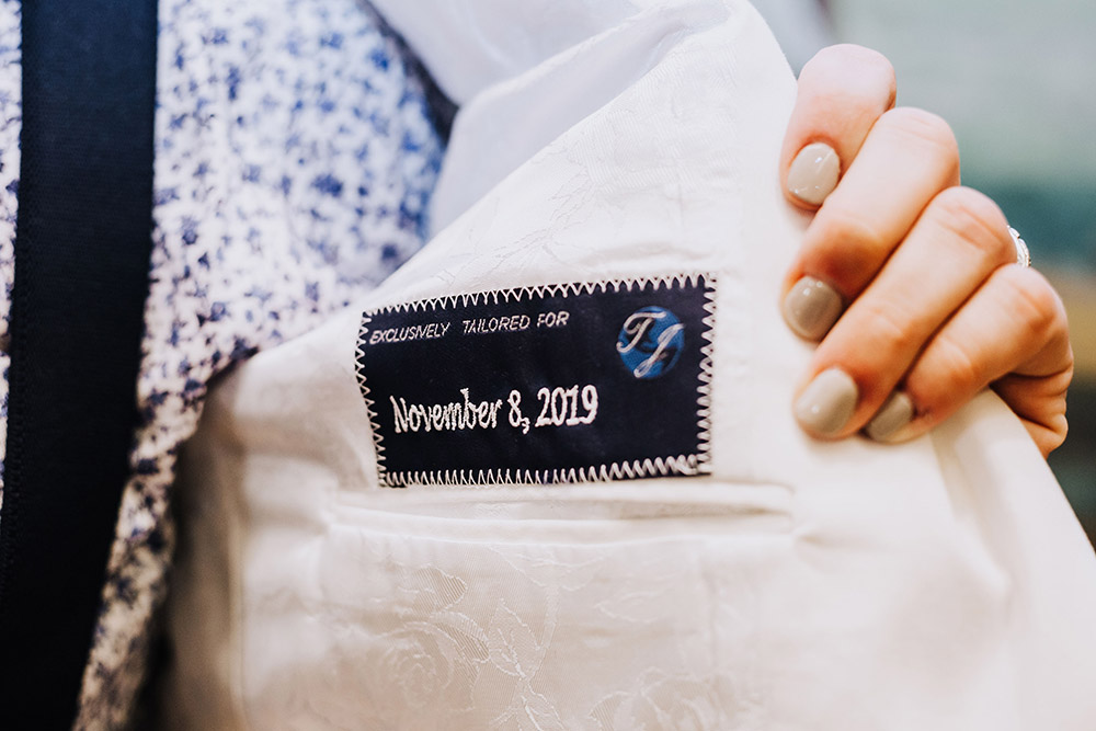 "jacket patch that reads ""exclusively tailored for November 8, 2019"""