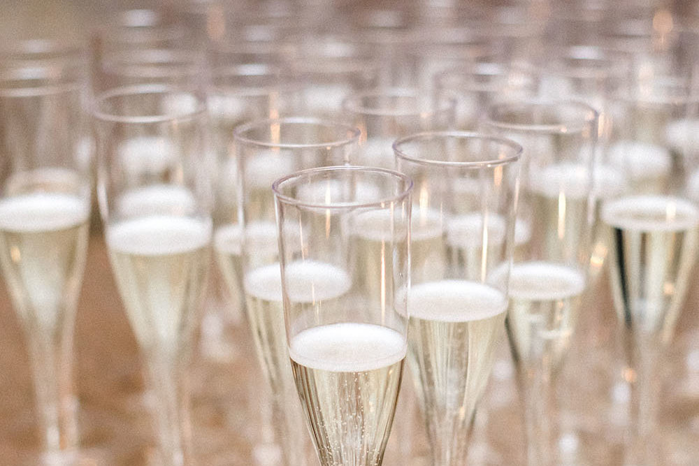 A group of champagne filled glasses at wedding