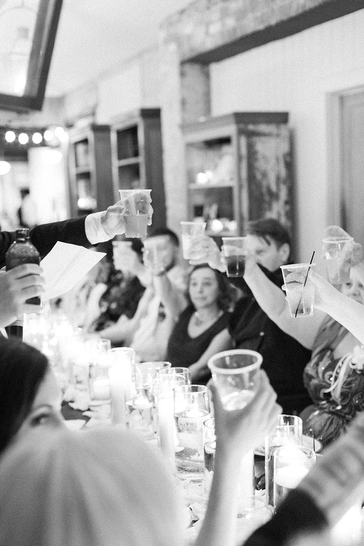 wedding toast black and white photo