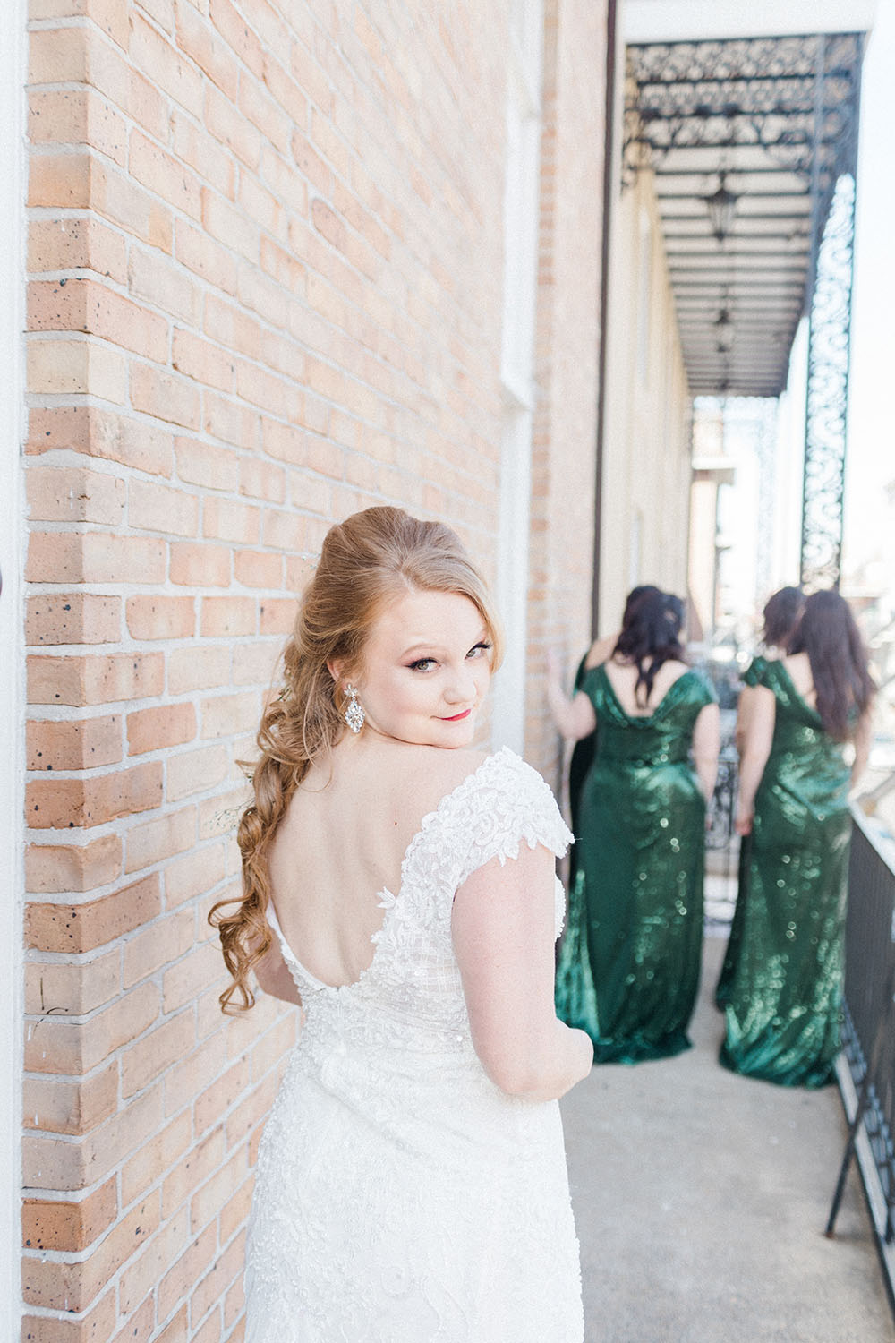 outdoor wedding day photos bride in foreground and bridesmaids in background