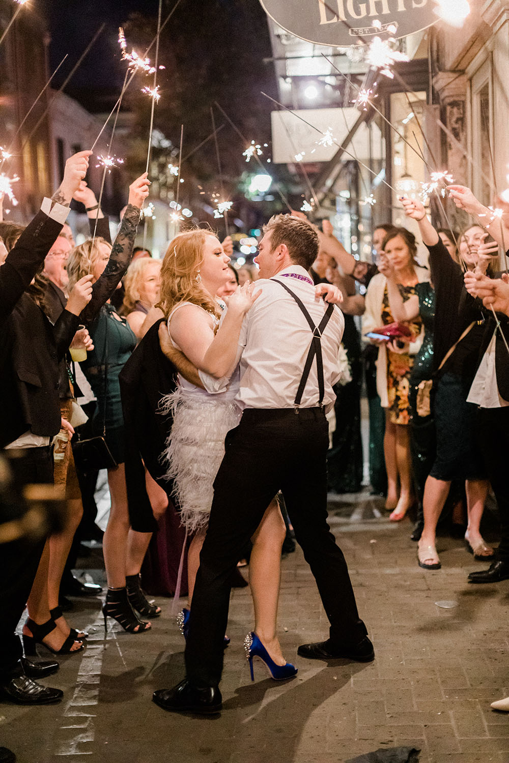 french quarter wedding couple outside and surrounded by sparklers