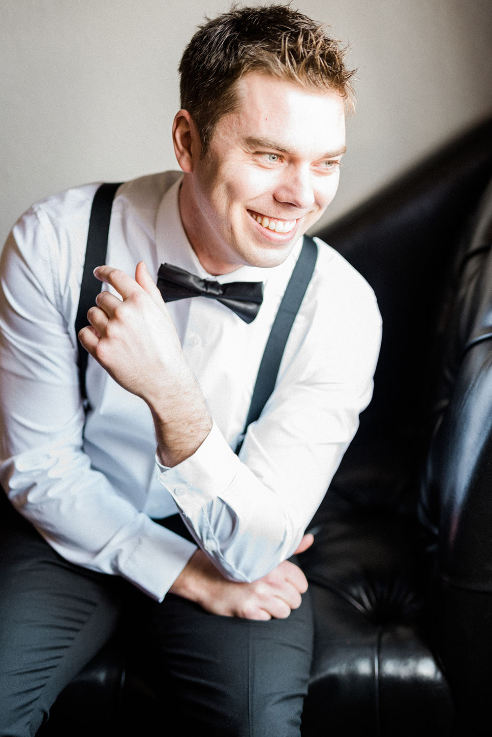 candid photo of groom smiling