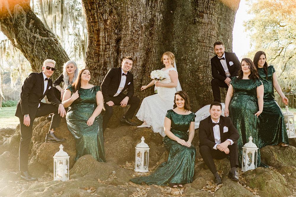 bridal party posing at the tree of life