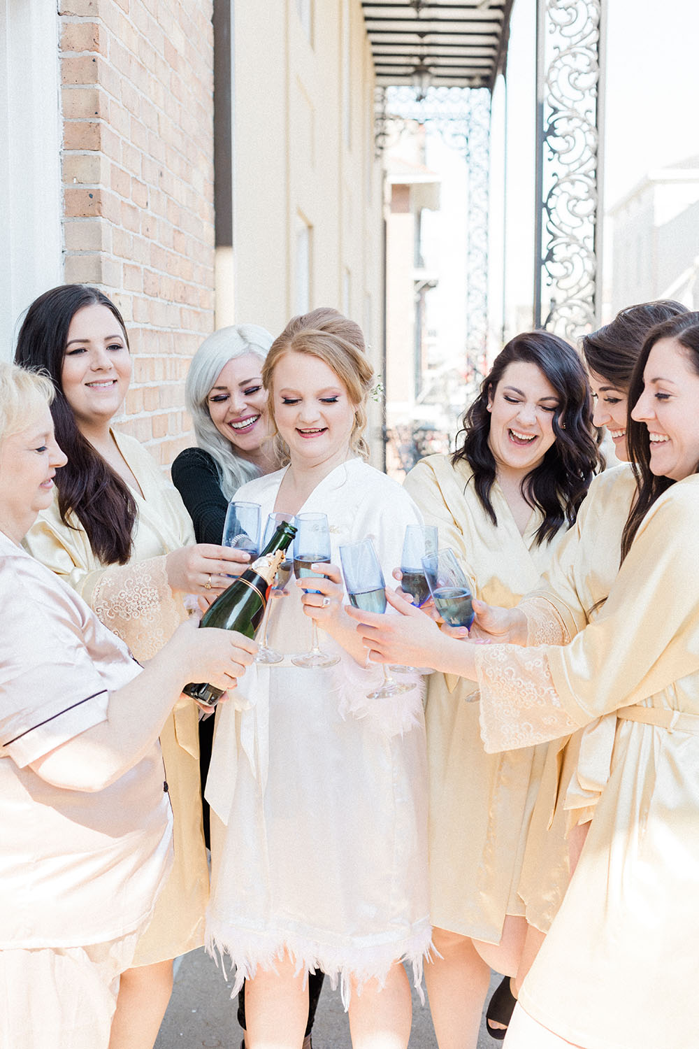 Bride and bridesmaids toasting chapagne