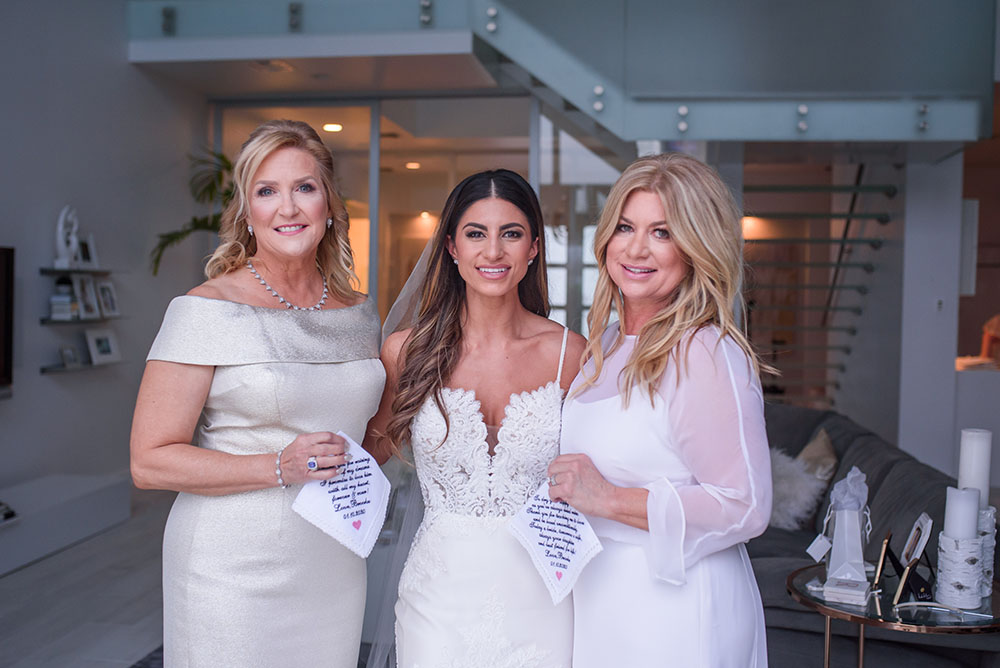 the bride with her mom and the mother of the groom