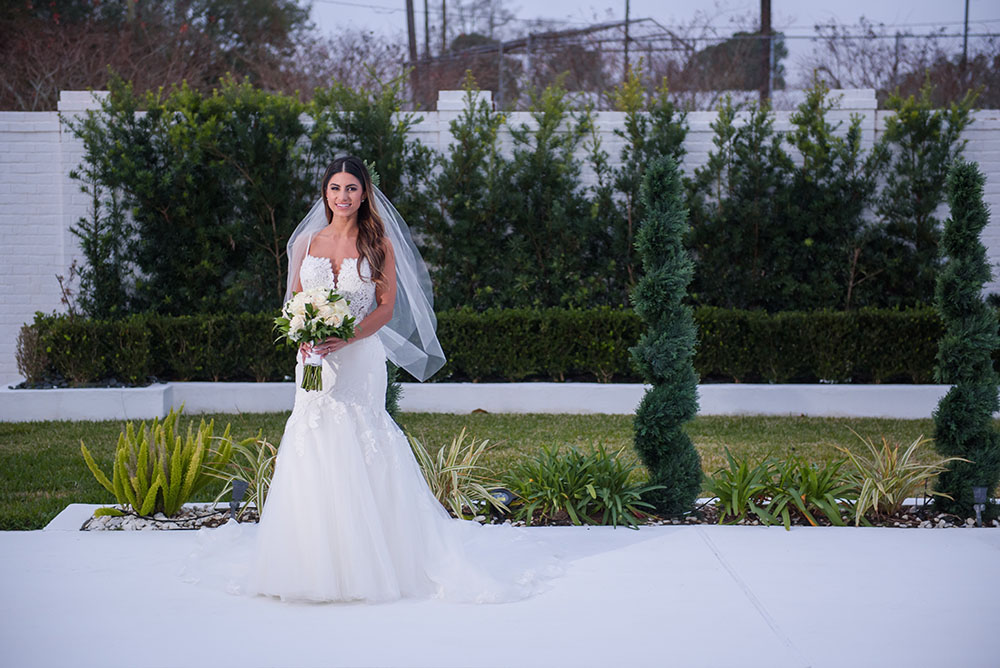 formal photo of bride outside