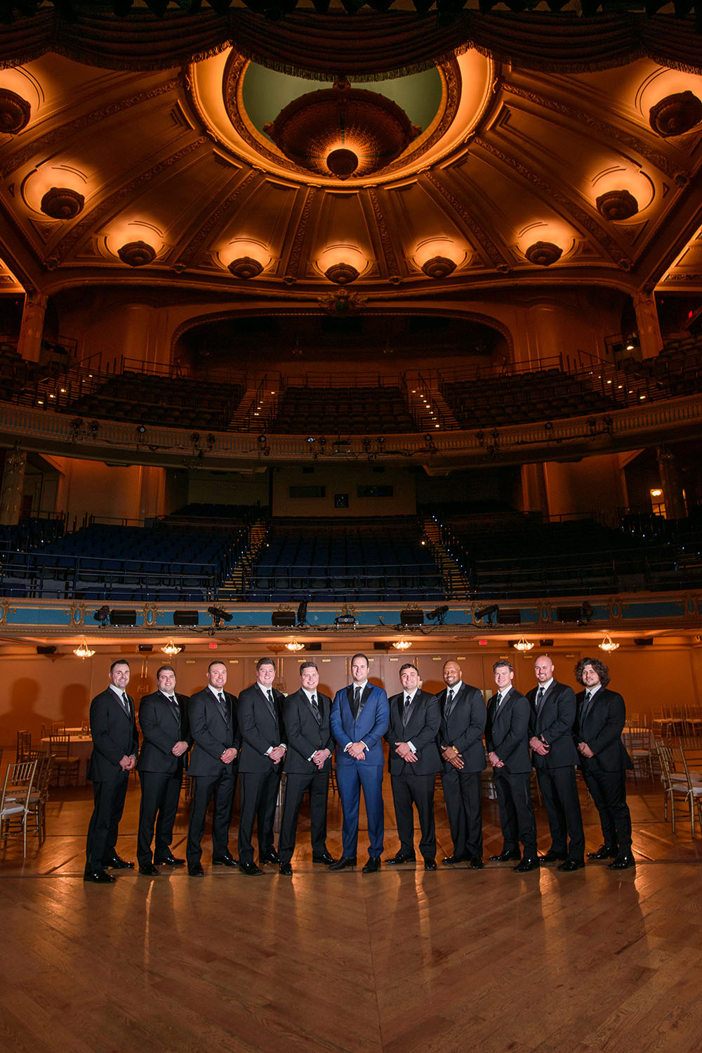 Groom and groomsmen pose at the orpheum