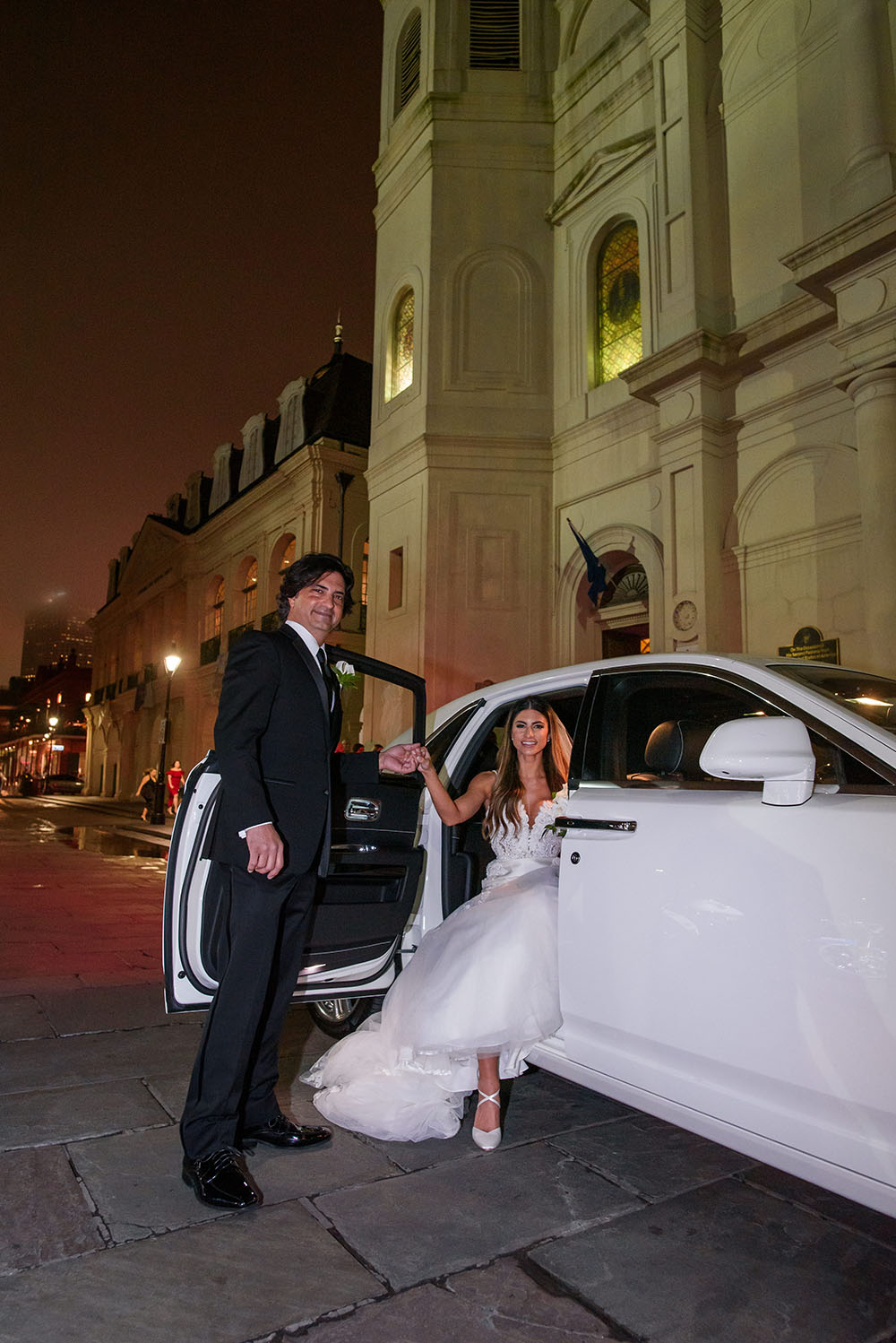 The bride getting out of the rolls royce just before her wedding