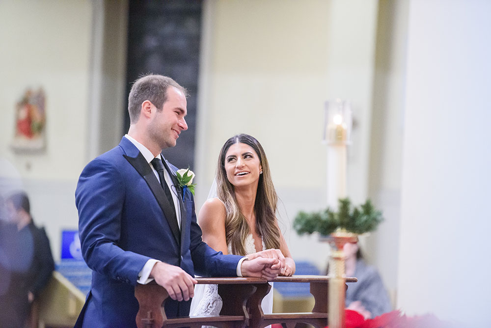 bride and groom sharing a smile during wedding ceremony