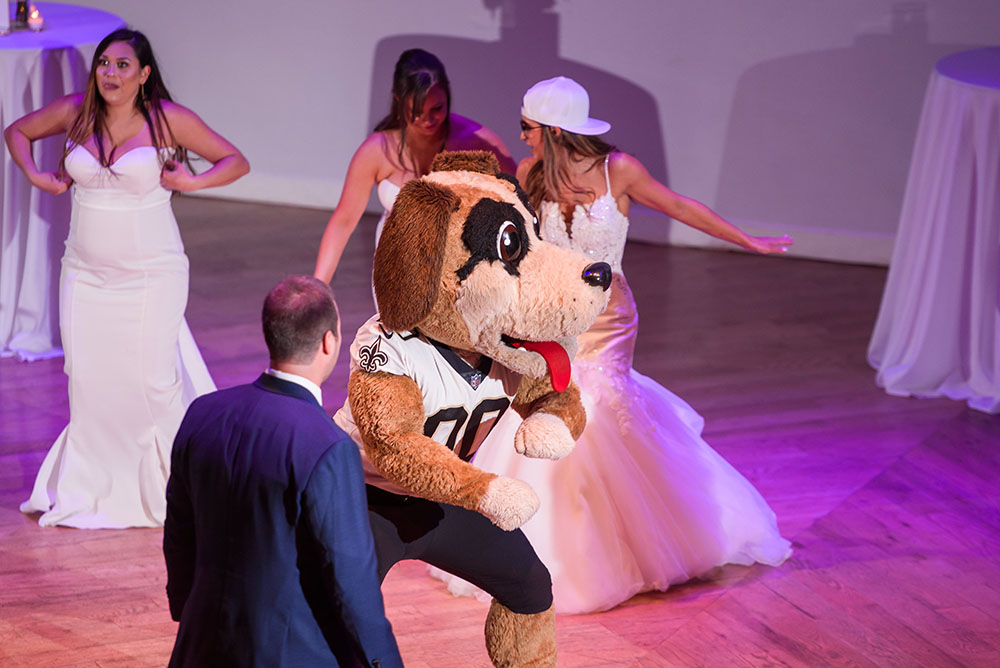 bride and groom getting down with Gumbo, the Saints Mascot
