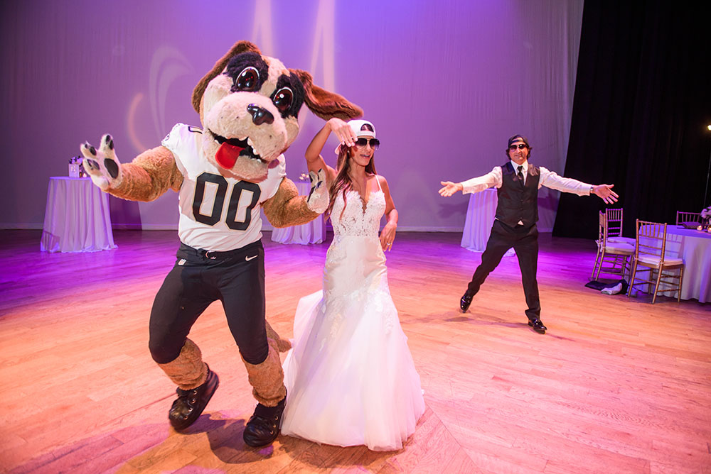 bride dancing with Saint's mascot