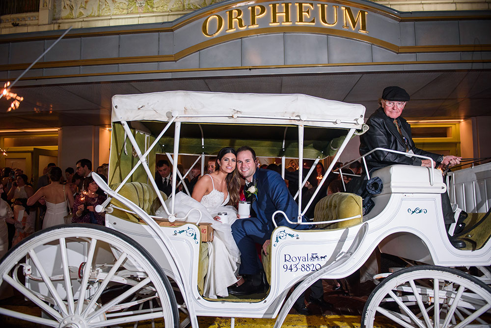 bride and groom in carriage outside the orpheum