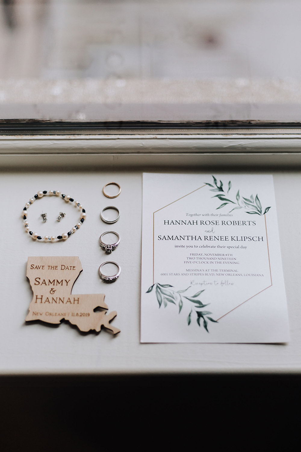 bridal details wedding rings and invitations