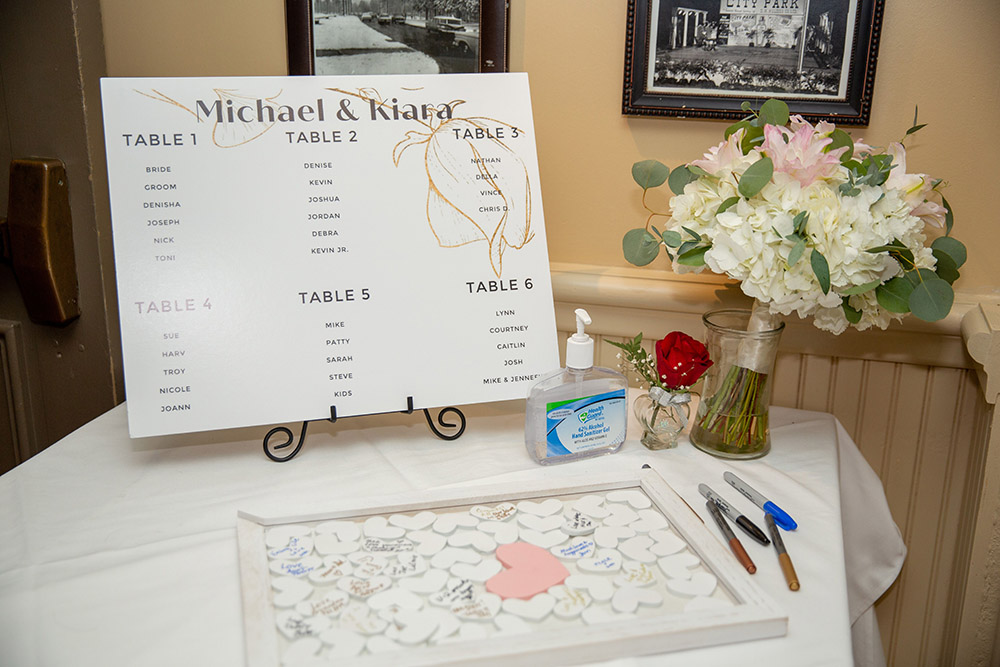 Kiara and Michael's seating chart and guest book. Photo: Brian Jarreau Photography