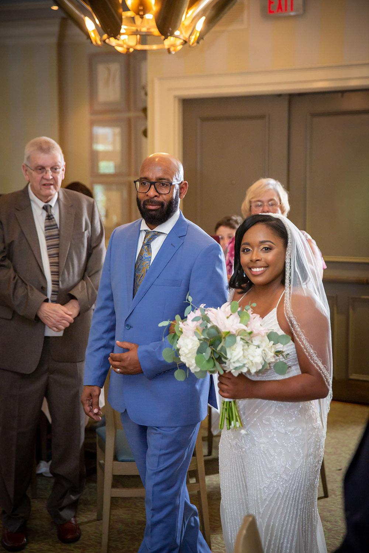 Kiara walks down the aisle during the wedding processional. Photo: Brian Jarreau Photography
