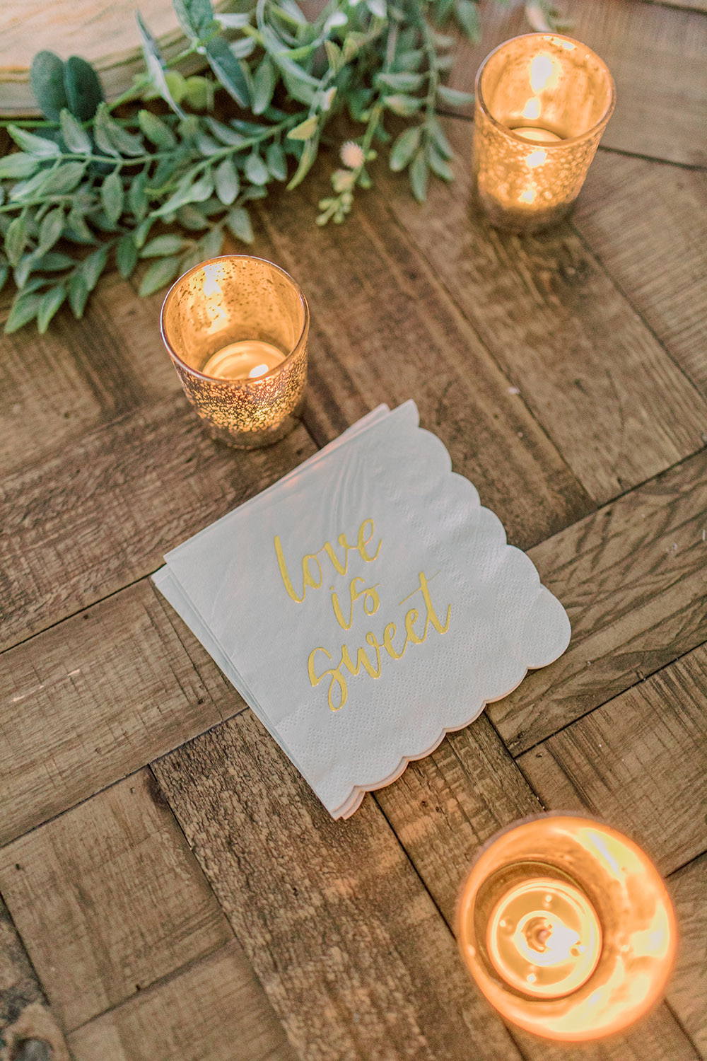 "Cocktail napkins embossed with ""Love is Sweet"". Photo: Ashley Kristen Photography"