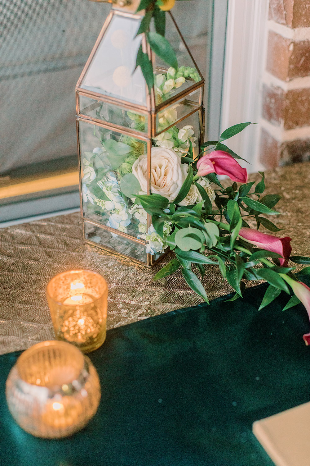 Lantern filled with fresh flowers. Photo: Ashley Kristen Photography