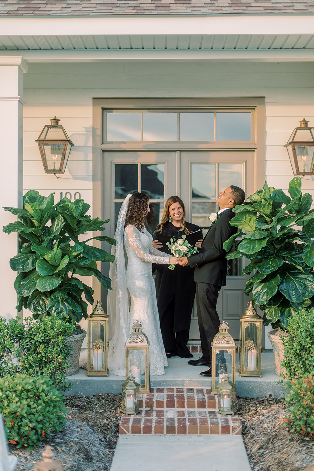 A bride and groom exchange vows during a front porch wedding ceremony. Photo: Ashley Kristen Photography